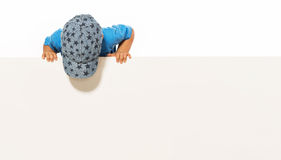 Little boy is above on the empty white placard. Isolated on white Stock Photos