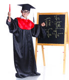 Little boy in academic hat. Doing complex math on black chalkboard. Isolated on a white background Stock Images