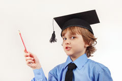 Little boy in academic hat with pencil on white background Royalty Free Stock Photography