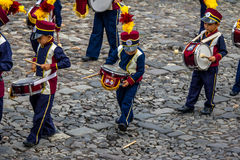 Little Boy accidentally drops his drum stick during Marching Band Parade - Antigua, Guatemala Stock Image