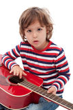 Little boy with  acoustic guitar Stock Images