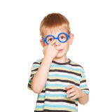 Little boy adjusting his glasses. Isolated on white Royalty Free Stock Photos