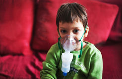 Little boy with aerosols inhaler Stock Photography