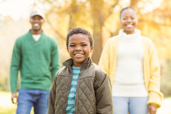 A little boy against his parents in the background Royalty Free Stock Photo