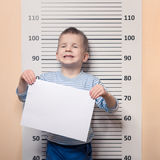 Little boy against police line-up Stock Image