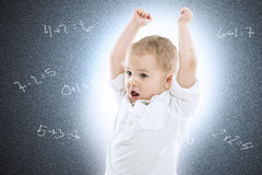 Little boy against a school blackboard Royalty Free Stock Image