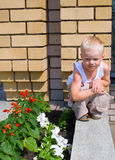 Little Boy Against Yellow Brick Wall Royalty Free Stock Photos