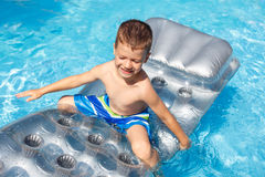 Little boy on air mattress Stock Photo