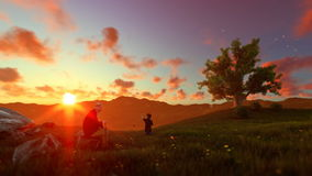 Little boy with airplane and grandfather resting on green meadow, sunrset, panning stock footage