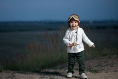 Little boy with airplane Stock Photos