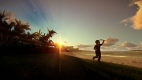 Little boy with airplane toy on a tropical beach at sunset. Hd video stock video