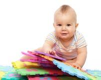 Little boy with alphabet Stock Photos