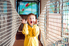 Little boy is amazed in amusement park with rope Royalty Free Stock Photos