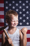 The little boy with the American flag in the background, Stock Photo