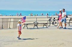 Little boy american flag boardwalk coney island ny Royalty Free Stock Image