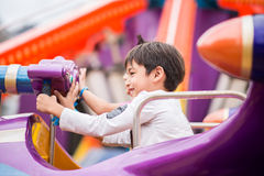 Little boy in amusement park outdoor Royalty Free Stock Images