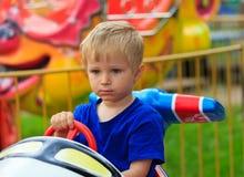 Little boy in amusement park. Portrait of little boy in amusement park Stock Photo