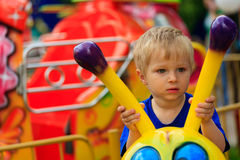 Little boy in amusement park Stock Photos