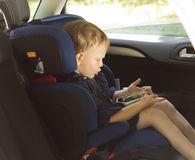 Little boy amusing himself in a car Royalty Free Stock Photos