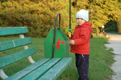 Little Boy And Garbage-can Royalty Free Stock Photos