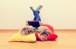 Free Little Boy And Girl Looking At Touch Pad, Home Learning Stock Image - 79512701