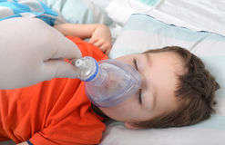 Little boy in anesthesia. Little boy under anesthesia with a oxygen mask Royalty Free Stock Photos