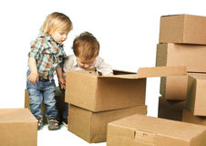 Little boy ang girl plays in boxes Stock Images