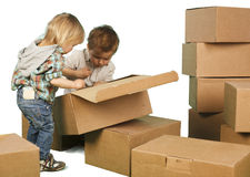 Little boy ang girl plays in boxes Stock Photography
