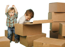 Little boy ang girl plays in boxes Stock Photo