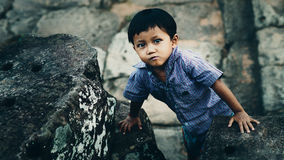 Little boy in Angkor Wat Stock Photography