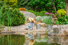 Little boy angling. On the bank of a scenic pond stock photo