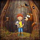 Little boy with the animals in the wood Stock Image