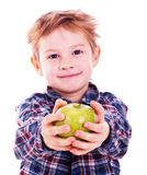 Little boy with apple. Stock Images