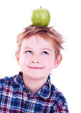 Little boy with apple. Royalty Free Stock Photo