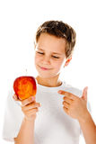 Little boy with apple Stock Images