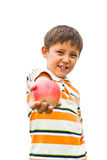 A little boy with an apple Stock Image