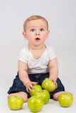 Little boy with an apple. Sitting on the floor Royalty Free Stock Photos