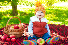 Little boy with apple in autumn Stock Images