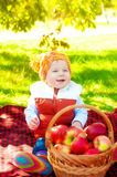 Little boy with apple in autumn Royalty Free Stock Photography
