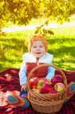 Little boy with apple in autumn Royalty Free Stock Photo