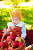 Little boy with apple in autumn Royalty Free Stock Images