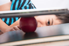 Little boy with apple on the book on his head education concept back to school Royalty Free Stock Photo