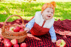 Little boy with apple in  park Stock Photography