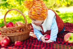 Little boy with apple in  park Royalty Free Stock Photography
