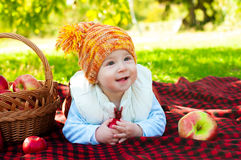 Little boy with apple in  park Royalty Free Stock Image