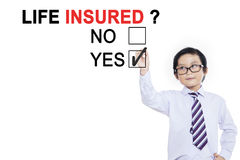 Little boy is approving life insured Stock Photos