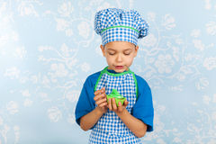 Little boy in apron baking cupcakes Royalty Free Stock Photos