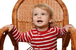 The little boy in an armchair Stock Images
