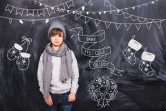 Little boy around the black chalkboards Stock Image