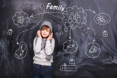 Little boy around the chalkboards Royalty Free Stock Images